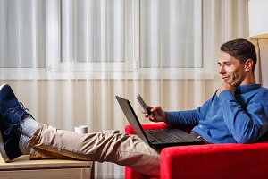 Man looks thoughtfully at laptop