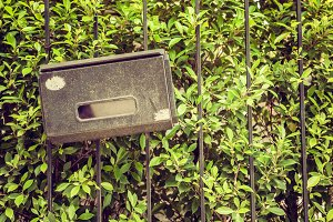 Old mail box hang on fence