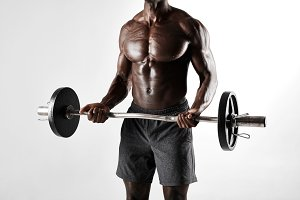 Muscular african male exercising