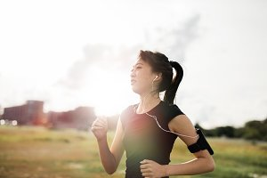 Young fitness woman on morning run