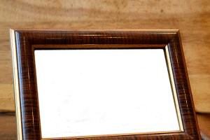 Photo frame on wooden desk
