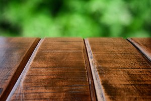 wooden table and green yard