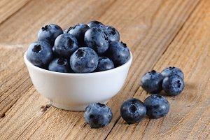 Blueberry in bowl on wooden table