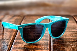 Sunglasses on wooden desk
