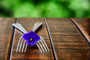 Two forks with a flower