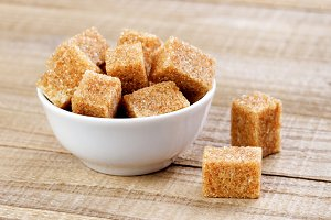 Cubes of brown sugar in bowl