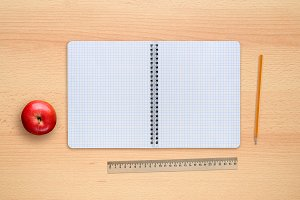 Notebook, apple, pencil and ruler