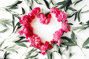 Heart symbol made of peonies