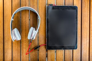 tablet PC and white headphones