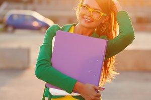 Business. Girl holds a folder.