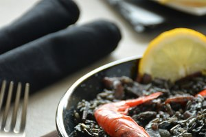 paella of rice black with Squid