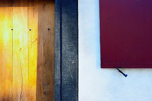 Red shutters and yellow wooden door