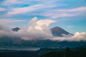 Evening sunset nature of Batur volcano and Agung mountain surrounded by fantastic clouds in Kintamani region, Bali, Indonesia