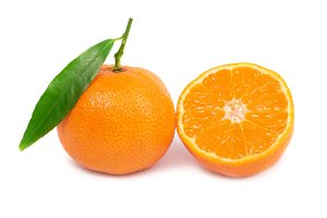 Orange mandarins with green leaf