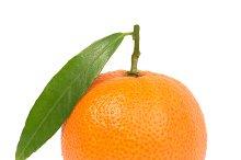 Orange mandarin with green leaf