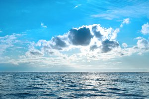 Sea with blue water, sky and clouds