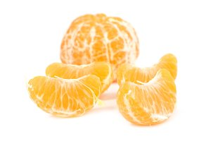 Orange peeled mandarin and slices