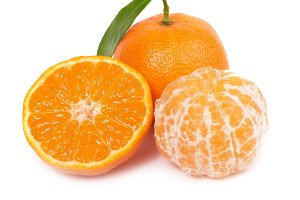 Orange mandarins with green leaf