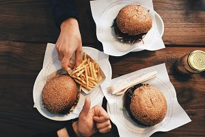 Top view of fresh burgers on table
