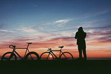 Silhouette of hipster man at sunrise