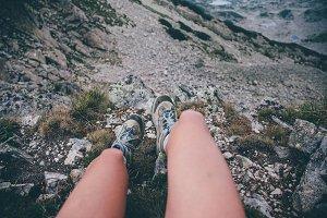 Girls feet over a mountain