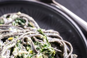 Black pasta with spinach