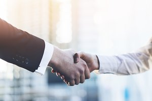 Business partners making handshake