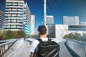 Man on a diverging bridge