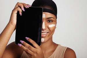 woman with a smartphone on face