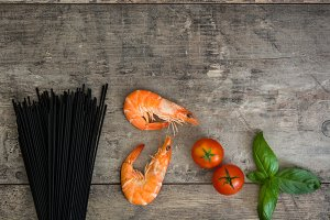 Raw black spaghetti with prawns