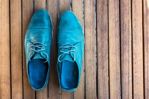 Man shoes on wooden background