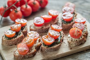 Toasts with tahini and mint sauce
