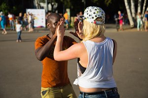 Blonde and black guy dancing