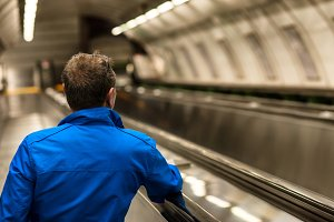 Man on subway escalator