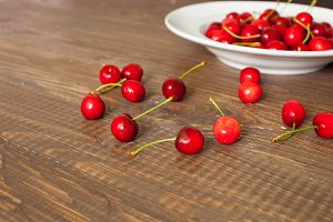 cherries on the brown wooden table