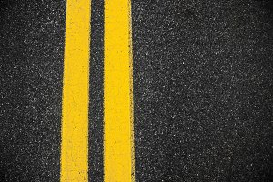 yellow double lines asphalt road