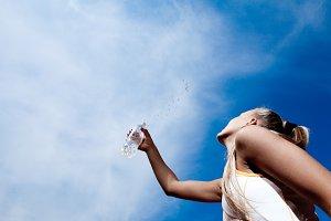 sporty woman sprinkling water