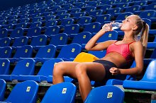 athletic woman drink water