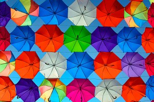 colored umbrellas in blue sky
