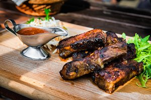 pork ribs with sauce and salad