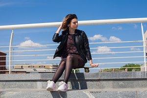 girl sitting on the skateboard