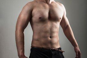 muscle man model posing in studio