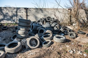 Old used tires dump in the city