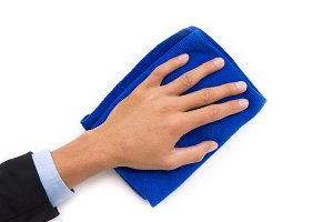 hand holding blue cleaning rag