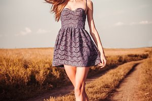 Beautiful girl in dress walking
