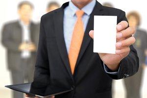 Businessman showing blank card