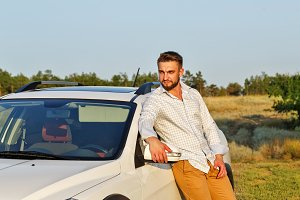 Man and his car in the steppe.