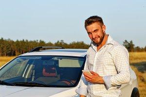 Man, car and smart phone.