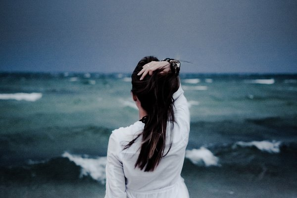 Girl Watching the Storm on the Sea