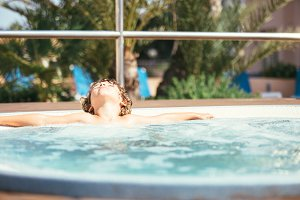 Child relaxing in a jacuzzi
